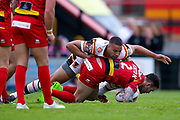Bradford Bulls winger Omari Caro (18) tackles  Dewsbury Rams Dale Morton (2) during the Kingstone Press Championship match between Dewsbury Rams and Bradford Bulls at the Tetley's Stadium, Dewsbury, United Kingdom on 4 June 2017. Photo by Simon Davies.