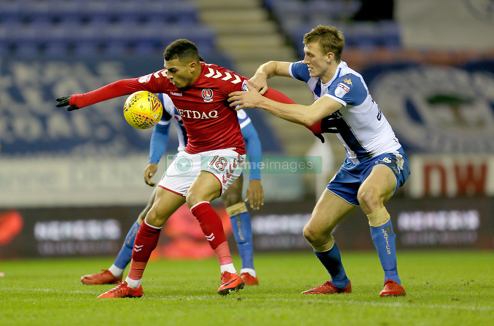 Charlton Athletic's Karlan Ahearne-Grant and Wigan's Dan Burn battle for the ball
