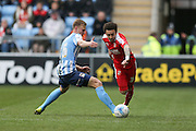 Coventry City midfielder Andy Rose (16)  fouls Swindon Town defender Brandon Ormonde-Ottewill (3)  during the Sky Bet League 1 match between Coventry City and Swindon Town at the Ricoh Arena, Coventry, England on 19 March 2016. Photo by Simon Davies.