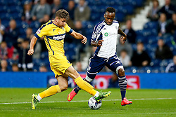Saido Berahino of West Brom is challenged by Joe Riley of Oxford United - Photo mandatory by-line: Rogan Thomson/JMP - 07966 386802 - 26/08/2014 - SPORT - FOOTBALL - The Hawthorns, West Bromwich - West Bromwich Albion v Oxford United - Capital One Cup Round 2.