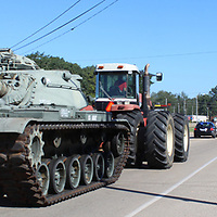 RAY VAN DUSEN/BUY AT PHOTOS.MONROECOUNTYJOURNAL.COM<br /> An M60 tank is pulled by a tractor down Will Robbins Highway en route to its new home at Veterans Park.