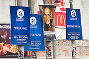 El Salvador government signage welcoming the world stands against McDonalds billboards in San Salvador. El Salvador prepares for the beatification ceremony and mass announcing the beatification of Archbishop Oscar Romero. The Archbishop was slain at the alter of his Church of the Divine Providence by a right wing gunman in 1980. Oscar Arnulfo Romero y Galdamez became the fourth Archbishop of San Salvador, succeeding Luis Chavez, and spoke out against poverty, social injustice, assassinations and torture. Romero was assassinated while offering Mass on March 24, 1980.