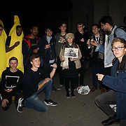 London,England,UK: 28th Oct 2016: A group of young students hold a Harambe the Gorilla Candlelight Vigil  since five agos saving the toddler or Harambe the Gorilla killed in a zoo in Ohia at Hype Park Corner, London,UK. Photo by See Li