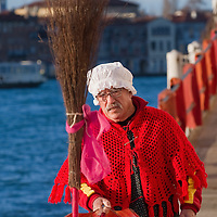 "VENICE, ITALY - JANUARY 06:  Gianni Colombo called ""timbro""  put some final touches ahead of the 34th  Befana Regata on January 6, 2012 in Venice, Italy.  In Italian folklore, Befana is an old woman who delivers gifts to children throughout Italy on the feast of the Epiphany on January 6 in a similar way to Saint Nicholas or Santa Claus."