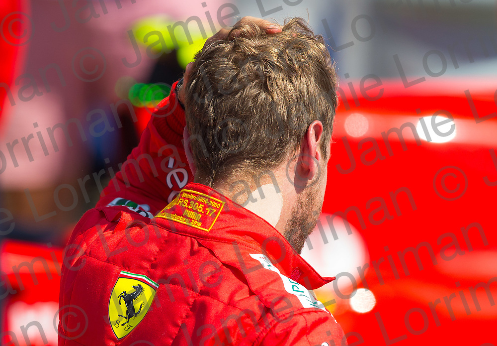 The 2018 Formula 1 F1 Rolex British grand prix, Silverstone, England. Sunday 8th July 2018.<br /> <br /> Pictured: Winning driver Sebastian Vettel of Scuderia Ferrari was injured over the weekend at the British Formula 1 Grand Prix at Silverstone.<br /> <br /> Jamie Lorriman<br /> mail@jamielorriman.co.uk<br /> www.jamielorriman.co.uk<br /> 07718 900288