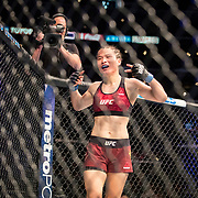 Weili Zhang (maroon trunks) defeated Danielle Taylor in a strawweight bout at UFC 227 held at the Staples Center in Los Angeles on August 4, 2018. Photo by Todd Bigelow for ESPN.
