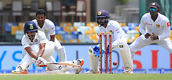 August 4, 2017 - Colombo, Sri Lanka - Indian cricketer ..Wriddhiman Saha(L) plays a shot as Sri Lanka's Dimuth Karunarathne,Niroshan Dickwella and Angelo Mathews look on during the 2nd Day's play in the 2nd Test match between Sri Lanka and India at the SSC international cricket stadium at the capital city of Colombo, Sri Lanka on Friday 04 August 2017. (Credit Image: © Tharaka Basnayaka/NurPhoto via ZUMA Press)