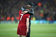 It's all over and Liverpool midfielder James Milner (7) gets a hug from Liverpool Manager Jurgen Klopp during the Champions League semi-final, leg 2 of 2 match between Liverpool and Barcelona at Anfield, Liverpool, England on 7 May 2019.