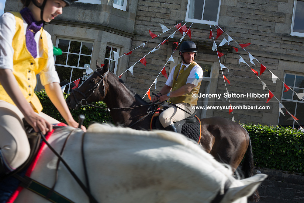 The horses set off on the 'Riding of the Marches', at The Peebles Beltane Festival, including their Common Riding of the Marches, with Cornet Daniel Williamson, and Cornets Elect Lass Susan Thomson, in Peebles, Scotland, Wednesday 19th June 2013. <br /> N55&deg;38.958'<br /> W3&deg;11.463'