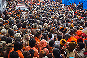 Naga sathus gather together as they walk towards the river to take a dip in it during the Hindu Festival of Maha Kumbh Mela Haridwar, Uttarakhand, India