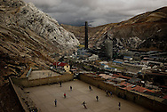 Youth play soccer in La Oroya next to the American-owned smelter Doe Run Peru. This photo was taken in April 10, 2009, when production was almost completelly suspended due to a financial crisis in the company, now it is still closed. The company claims that it was not able to carry out its environmental program, a violation of its agreement with the goverment arging economic reasons, in the meantime it was operating in defiant of enviromental regulations, in a city where many children have tested for high lead levels in their blood due to smelter pollution.