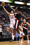 Oct 11, 2017; Phoenix, AZ, USA; Phoenix Suns guard Mike James (55) lays up the ball against Portland Trail Blazers forward Al-Farouq Aminu (8) in the first half at Talking Stick Resort Arena. Mandatory Credit: Jennifer Stewart-USA TODAY Sports