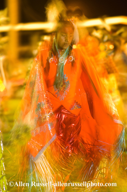 Teenage girl, blurred motion, Womens Fancy Shawl Dance, Crow Fair, powwow, Crow Indian Reservation, Montana