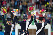 Podium Grand Prix Special 1. Charlotte Dujardin and Valegro, 2. Helen Langehanenberg and Damon Hill, 3 Kristina Sprehe and Desperados <br /> Alltech FEI World Equestrian Games™ 2014 - Normandy, France.<br /> © DigiShots