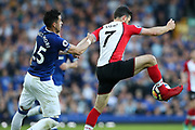 Southampton striker Shane Long (7) and Everton defender Ramiro Funes Mori (25)  during the Premier League match between Everton and Southampton at Goodison Park, Liverpool, England on 5 May 2018. Picture by Craig Galloway.