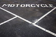 Motorcycle parking bay in a tarmac car park in Middlesborough, England, UK.