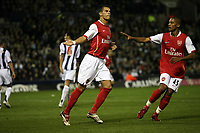 Photo: Rich Eaton.<br /> <br /> West Bromwich Albion v Arsenal. Carling Cup. 24/10/2006. Jeremie Aliadiere scores from the penalty spot and celebrates with Armand Traore #45