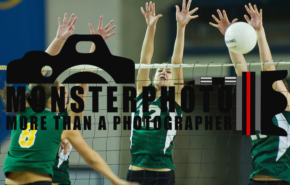 11/13/11 Newark DE: Archmere Mary.Tobin #11 and Megan Carney #12 performing a block during the 2011 State Championship game...St. Mark's defends their state title by defeating Archmere in three straight sets in front of fans at The Bob Carpenter on Sunday Nov. 13, 2011 in Newark Delaware...Special to The News Journal/SAQUAN STIMPSON