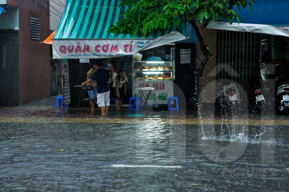 Flooded street during monsoon season, Nha Trang, Vietnam, Southeast Asia