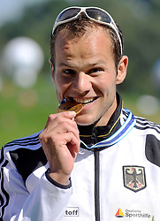 MAX HOFF (GERMANY) POSES WITH HIS GOLD MEDAL IN MEN'S K1 1000 METERS FINAL A RACE DURING 2010 ICF KAYAK SPRINT WORLD CHAMPIONSHIPS ON MALTA LAKE IN POZNAN, POLAND...POLAND , POZNAN , AUGUST 21, 2010..( PHOTO BY ADAM NURKIEWICZ / MEDIASPORT ).