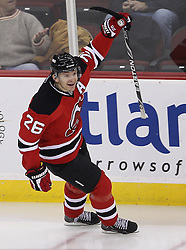 Feb 16; Newark, NJ, USA; New Jersey Devils left wing Patrik Elias (26) celebrates his game winning goal on Carolina Hurricanes goalie Cam Ward (30) during the third period at the Prudential Center. The Devils defeated the Hurricanes 3-2.
