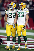 Green Bay Packers tight end Richard Rodgers (82) celebrates with Green Bay Packers wide receiver Jeff Janis (83) after Janis catches a 41 yard Hail Mary pass for a touchdown that ties the score at 20-20 with no time left on the game clock, sending the game into overtime during the NFL NFC Divisional round playoff football game against the Arizona Cardinals on Saturday, Jan. 16, 2016 in Glendale, Ariz. The Cardinals won the game in overtime 26-20. (©Paul Anthony Spinelli)