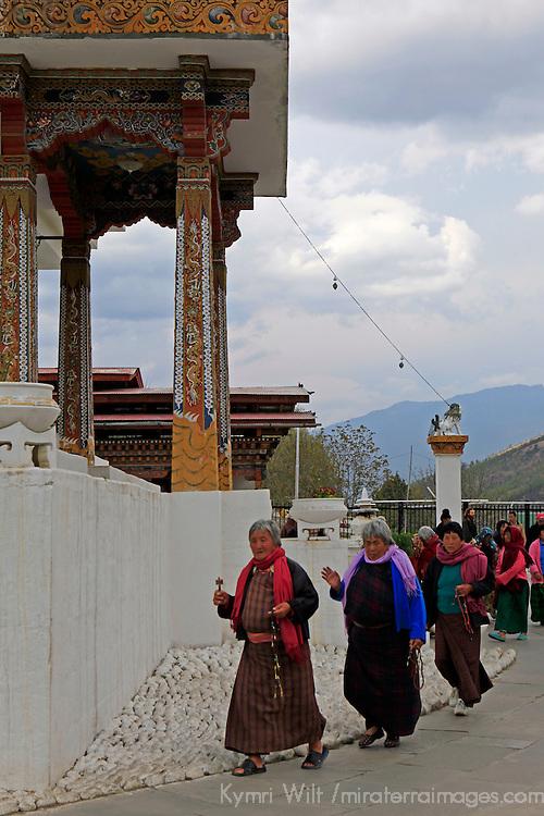 Asia, Bhutan, Thimpu. Women circumambulating the Memorial Chorten.