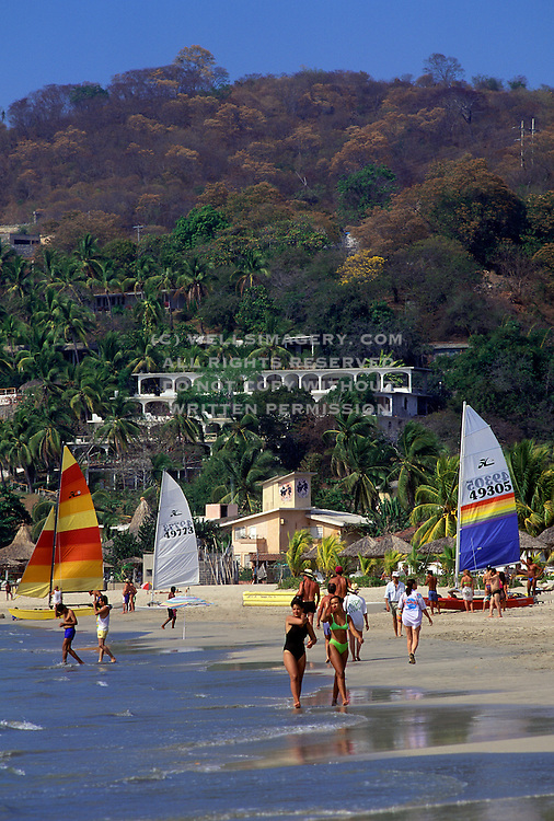 Image of people on the beach in Zihuatenejo, Mexico