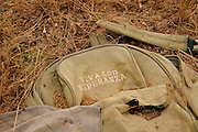 """Evidence of smuggling is found along a well-known smuggling route in Sahuarita, Arizona, USA.  The words on the backpack translate from Spanish to English as, """"Living with Hope""""."""