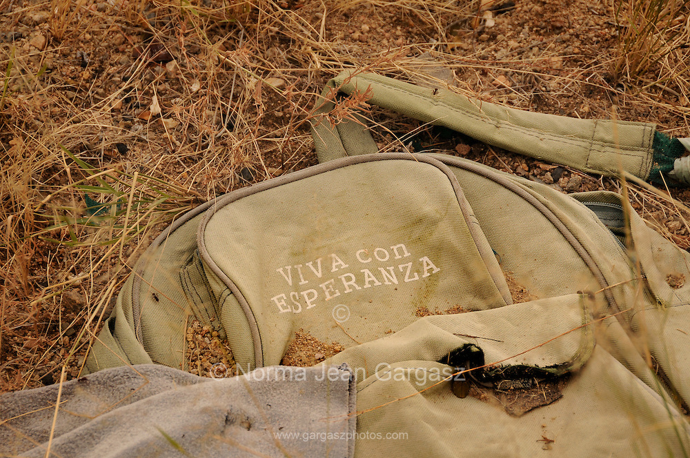 "Evidence of smuggling is found along a well-known smuggling route in Sahuarita, Arizona, USA.  The words on the backpack translate from Spanish to English as, ""Living with Hope""."