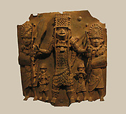 The Benin Bronzes are a collection of more than 3000[ brass plaques from the royal palace of the Kingdom of Benin (located in present day Nigeria). They were seized by a British force in the Punitive Expedition of 1897. Bronzes are now believed to have been cast in Benin since the thirteenth century, and some in the collection date from the 15th and 16th centuries  A warrior flanked by two shield bearers.