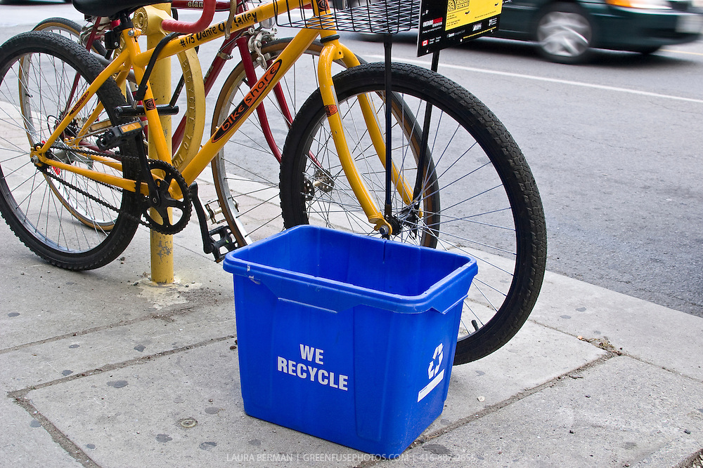 We recycle! A blue recycling bin and a yellow BikeShare bicycle: the epitome of urban environmentalism.