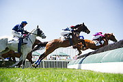 April 28, 2018: Queen's Cup Steeplechase. BOSS MAN (pink silks) ridden by Michael Mitchell, trained by Archibald J Kingsley and owned by Bill and Carrington Price clears the last and goes on to win the THE KING GEORGE III Sport of Kings Maiden Hurdle at Queen's Cup Steeplechase.