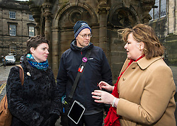 Pictured: Kathleen Brogan, managing Director of Mercat Tours and Gary Mill, tour guide with Mercat Tours provided some history lessosn for Fiona Hyslop outside the Mercat Cross.<br /> <br /> Ahead of parliamentary debate on the Year of History, Heritage and Archaeology, Culture Secretary Fiona Hyslop visited Edinburgh's Mercat Cross on the High Street to learn how Scotland is capitalising on the booming demand from tourists to explore the nation's history and genealogy. <br /> Ger Harley | EEm 31 January 2017