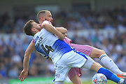 Tom Lockyer and Aaron Wilbraham during the EFL Sky Bet League 1 match between Bristol Rovers and Rochdale at the Memorial Stadium, Bristol, England on 22 April 2019.