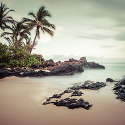 Secret Cove Beach Maui Hawaii Photo.  Also known as Makena Cove, Pa'ako Cove, and Wedding Beach, Secret Cove Beach is a popular beach in Wailea Kihei Hawaii. In the background is Ahihi Bay and the Pacific Ocean. Copyright ⓒ 2019 Paul Velgos with All Rights Reserved.