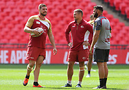 Remi Casty (L) captain of Catalan Dragons chats to his players during the Catalan Dragons Captains Run ahead of the Ladbrokes Challenge Cup Final at Wembley Stadium, London<br /> Picture by Stephen Gaunt/Focus Images Ltd +447904 833202<br /> 24/08/2018