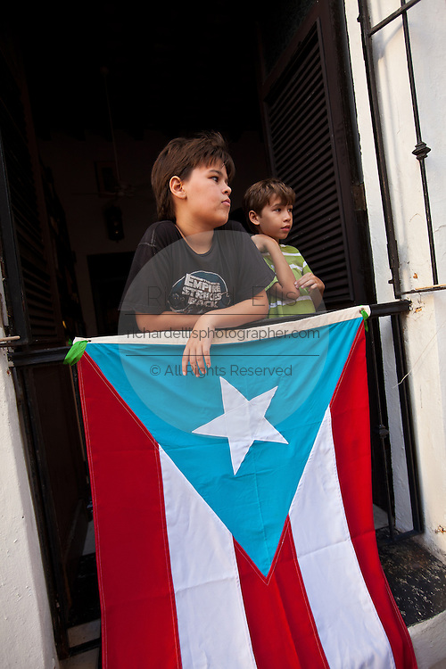Young boys watch the parade of the Festival of San Sebastian in San Juan, Puerto Rico.