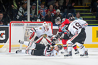 KELOWNA, CANADA - NOVEMBER 21: Brendan Burke #1 of Portland Winterhawks defends the net as Jesse Lees #2 of Kelowna Rockets is blocked by Burke's teammates Ethan Price #3 and Nicolas Petan #19 on November 21, 2014 at Prospera Place in Kelowna, British Columbia, Canada.  (Photo by Marissa Baecker/Shoot the Breeze)  *** Local Caption *** Nicolas Petan; Ethan Price; Brendan Burke; Jesse Lees;