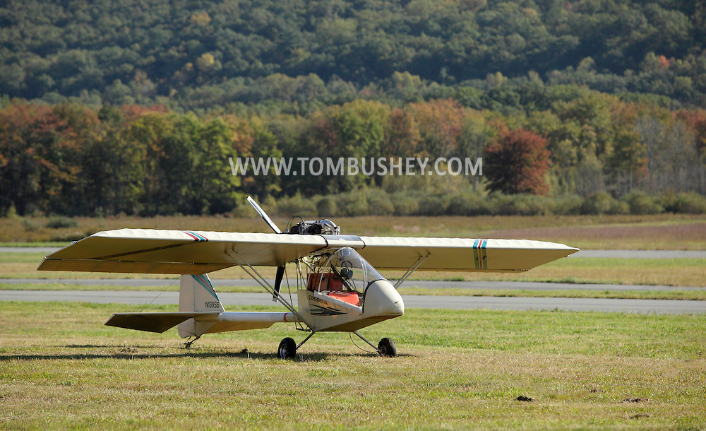 Wurtsboro, New York - A Kolb FireFly ultralight airplane is parked at Wurtsboro Airport during the annual Fly In - Drive- In Breakfast on Oct. 9, 2011. The firefly is an experimental light sport aircraft produced by the company founded by ultralight pioneer Homer Kolb.