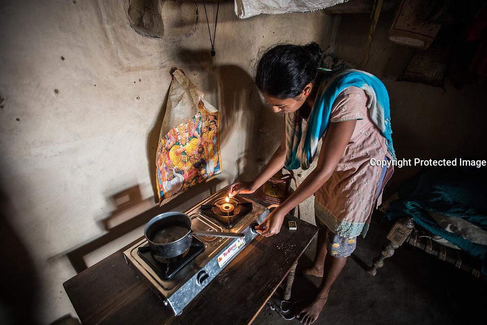 India, Woman lighting her LPG cookstove.