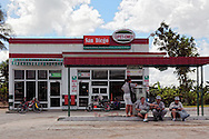 People waiting at a gas station in San Diego de los Banos, Pinar del Rio, Cuba.