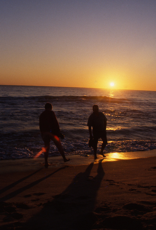 Couple on a beach at sunset, Scarborough, Perth, Western Australia