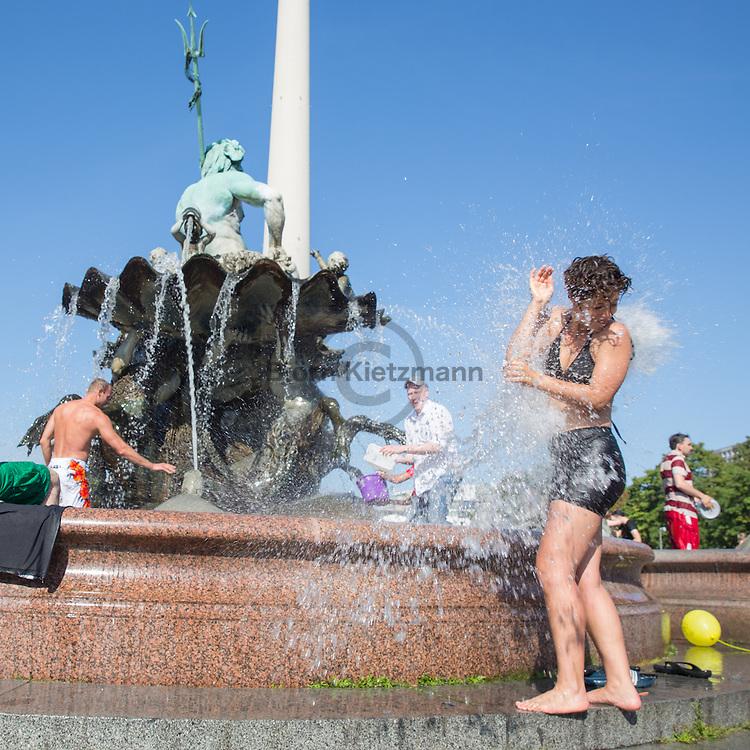 Berlin, Germany - 09.08.2015<br /> <br /> Water fight in the Neptune Fountain. Dozens of people followed a call on Facebook for a water fight in Berlin-Mitte.<br /> <br /> Wasserschlacht im Neptunbrunnen. Dutzende Menschen folgten einem Aufruf auf Facebook zu einer Wasserschlacht in Berlin-Mitte.<br /> <br /> Photo: Bjoern Kietzmann