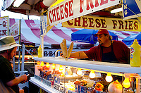 Food stall at dusk, customer and cook, Blue Hill Fair, Maine