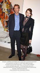 Model JASMINE GUINNESS and close friend GAWAIN RAINEY, at a party in London on 20th May 2003.PJU 201