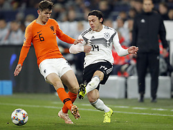 (L-R) Marten de Roon of Holland, Nico Schulz of Germany during the UEFA Nations League A group 1 qualifying match between Germany and The Netherlands at the Veltins Arena on November 19, 2018 in Gelsenkirchen, Germany