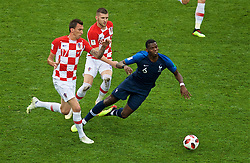 MOSCOW, RUSSIA - Sunday, July 15, 2018: France's Paul Pogba falls under pressure from Croatia's Mario Mandžukić and Ante Rebić during the FIFA World Cup Russia 2018 Final match between France and Croatia at the Luzhniki Stadium. (Pic by David Rawcliffe/Propaganda)