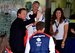 © Licensed to London News Pictures. 10/09/2012. Westminster, UK The British Prime Minister David Cameron arrives at a reception for Team GB. British stars of the Olympics and Paralympics celebrate their success with a victory parade through the streets of central London. Photo credit : Stephen Simpson/LNP