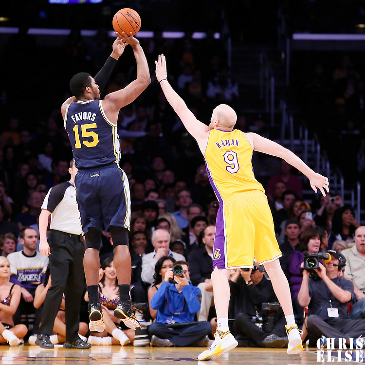 11 February 2014: Utah Jazz center Derrick Favors (15) takes a jumpshot over Los Angeles Lakers center Chris Kaman (9) during the Utah Jazz 96-79 victory over the Los Angeles Lakers at the Staples Center, Los Angeles, California, USA.